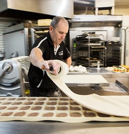 A baker preparing food at our bakery in the Geelong area